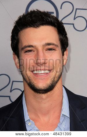 LOS ANGELES - JUL 24:  Drew Roy arrives at TNT's 25th Anniversary Party at the Beverly Hilton Hotel on July 24, 2013 in Beverly Hills, CA