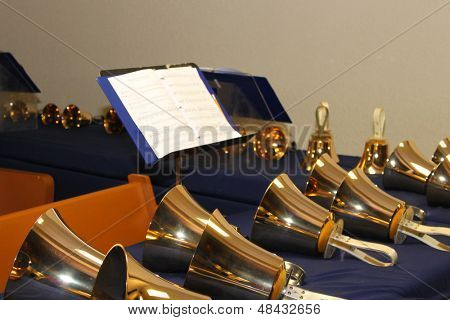 Large handbells set in a row and ready for performance