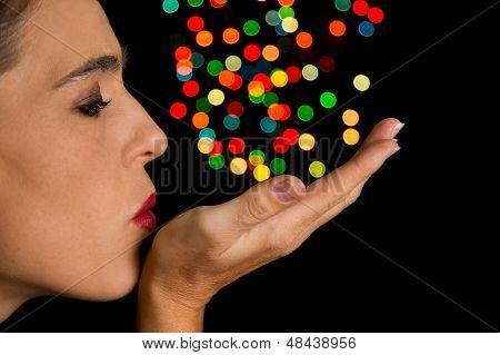 Woman Blow Round Bokeh Spots Off Her Hand