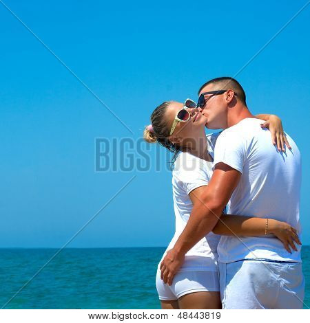 Young Couple In The Beach