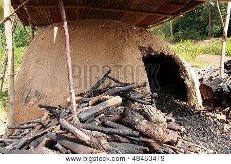 natural incinerator that it made from clay to burn firewood