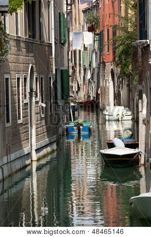 View of ancient buildings and narrow canal in Venice