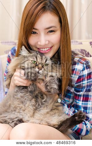 Thai Girl With A Cat.