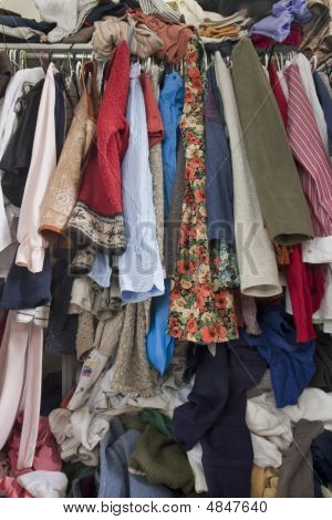 Messy Closet Overfilled With Clothes