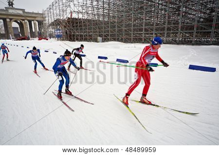 MOSCOW - FEB 9: Female skiers during FIS Continental Cup ski racing in category of city-event, Feb 9, 2013, Moscow, Russia. Track is constructed along central avenue at All-Russian Exhibition Center.