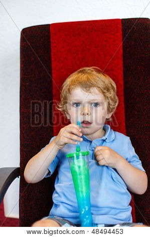 Little Boy Drinking Colorful Frozen Slush Ice