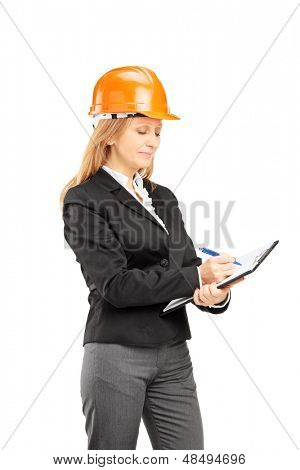 Female architect with a helmet writing on a clipboard isolated on white background