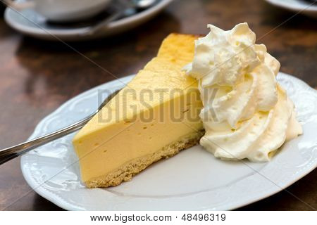 Cheese Cake with whipped Cream, close up