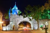 stock photo of dauphin  - Porte Dauphine gate closeup at night in Quebec City - JPG