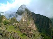 stock photo of old spanish trail  - light cloud crossing macchu picchu on a sunny day peru