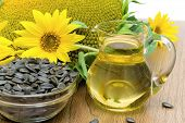 image of sunflower-seeds  - sunflower oil in a glass decanter sunflowers and ripe seeds close - JPG