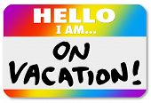 The words Hello I Am On Vacation on a colorful nametag sticker to illustrate having fun vacationing