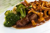 stock photo of chanterelle mushroom  - Tenderloin of Roe Deer Back with Chanterelle - JPG