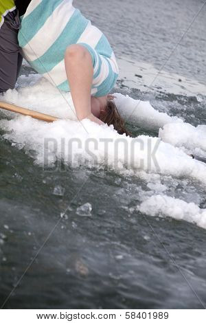 Girl Sticking Head In Ice Hole