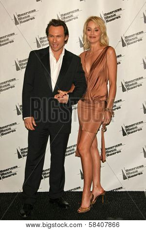 LOS ANGELES - NOVEMBER 21: Christian Slater and Sharon Stone in the press room at the 34th Annual American Music Awards at Shrine Auditorium on November 21, 2006 in Los Angeles, CA.