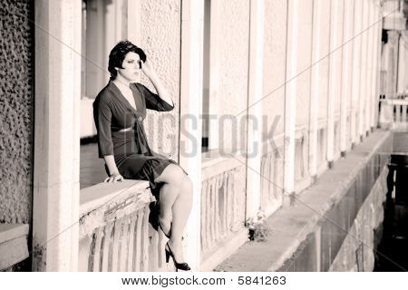 Woman On A Balcony