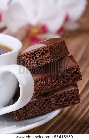 Cup Of Coffee And Aerated Chocolate. Macro Vertical