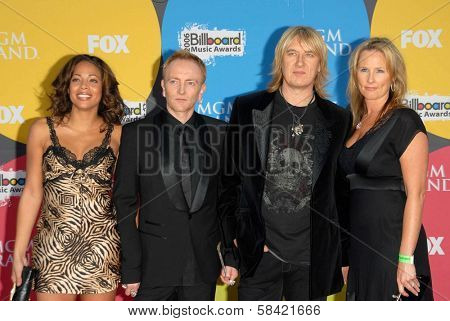 LAS VEGAS - DECEMBER 04: Phil Collen with wife Anita and Joe Elliott with wife Kristine arriving at the 2006 Billboard Music Awards, MGM Grand Hotel December 04, 2006 in Las Vegas, NV