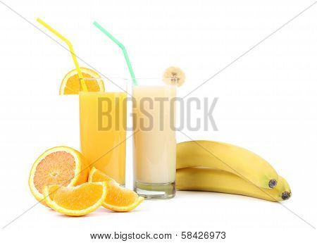 Juices of orange and banana. Fruits.