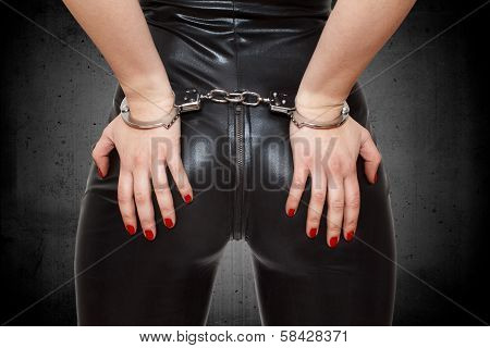 Sexy Dominatrix Hands On Ass In Handcuffs poster