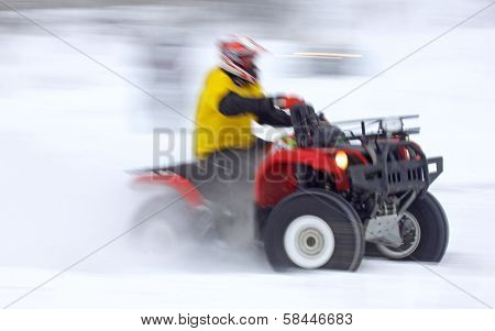 Quad Bike Driver Rides Over Snow Track