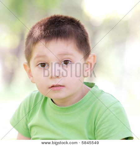 Portrait Of Boy In Green