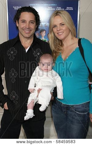 Jonathan Baker and Victoria Fuller with daughter Trease at the premiere of
