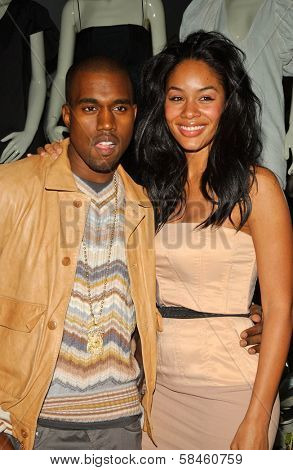 Kanye West and Alexis Rainey at Holiday Window Lighting to benefit the Kanye West Foundation Loop Dreams Program, Stella McCartney Boutique, Los Angeles, CA, December 5, 2006.