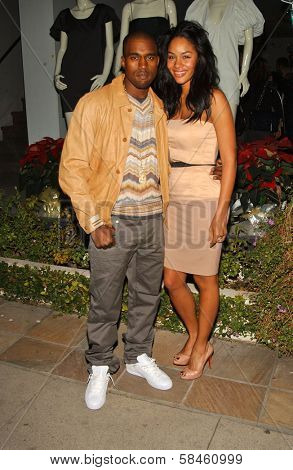 Kanye West and Alexis Rainey at the Stella McCartney Holiday Window Lighting to benefit the Kanye West Foundation Loop Dreams Program, Stella McCartney Boutique, Los Angeles, CA, December 5, 2006.