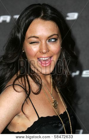 LOS ANGELES - OCTOBER 08: Lindsay Lohan winking at the Playstation 3 Launch Party October 08, 2006 in 9900 Wilshire Blvd, Beverly Hills, CA.