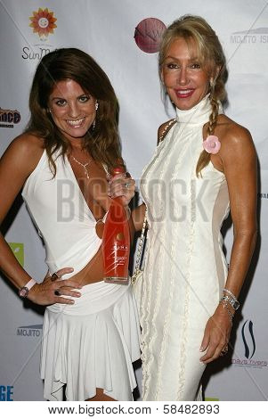 SANTA MONICA - JULY 23: Bridgetta Tomarchio, Linda Thompson at the Sexy Summer Soire Party hosted by H.U.G.E benefiting Heal The Bay at AKWA Restaurant and Club on July 23, 2006 in Santa Monica, CA.