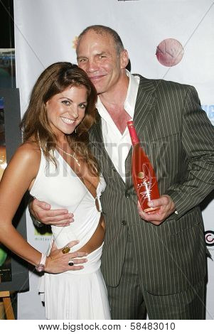 SANTA MONICA - JULY 23: Bridgetta Tomarchio and Patrick Kilpatrick at the Sexy Summer Soire Party by H.U.G.E benefiting Heal The Bay at AKWA Restaurant and Club on July 23, 2006 in Santa Monica, CA.
