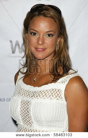 SANTA MONICA - JULY 23: Eva La Rue at the Sexy Summer Soire Party hosted by H.U.G.E benefiting Heal The Bay at AKWA Restaurant and Club on July 23, 2006 in Santa Monica, CA.