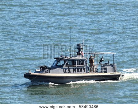 Navy Boat With Soldier Standing On Deck Patrol Area