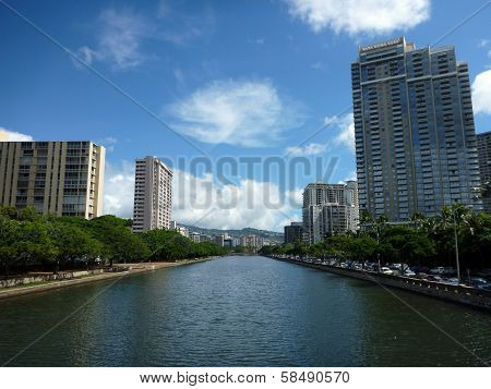 Ala Wai Canal, Hotels, Condos, And Trees On A Nice Day In Waikiki On Oahu