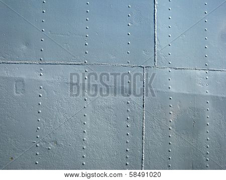 Detailed Gray Metal Historic Ship Wall With Seams And Rivets