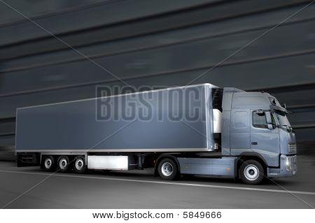 Blue Semi Truck In The Night