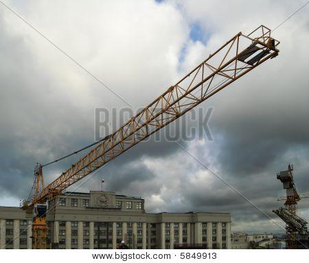 The crane against clouds
