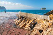 Old Breakwater Pier In Petrovac Town, Adriatic Sea, Montenegro