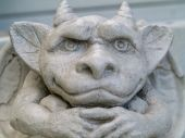 stock photo of gargoyles  - Gargoyle statue taken with emphasis on face and eyes - JPG