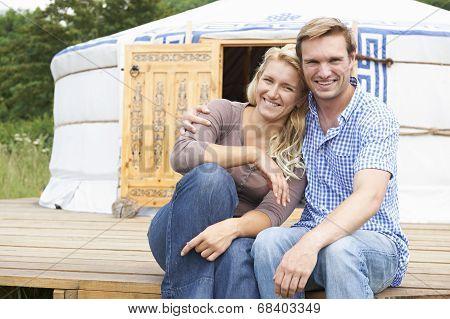 Couple Enjoying Camping Holiday In Traditional Yurt