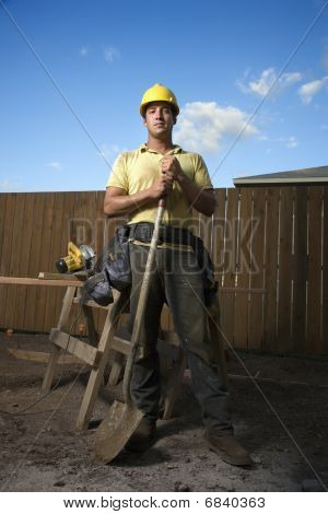 Construction Worker Standing With Shovel