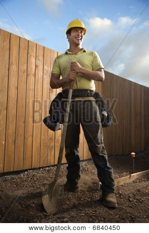 Smiling Construction Worker With A Shovel