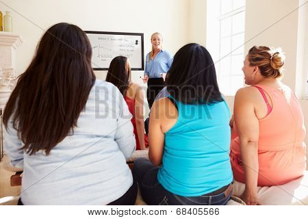 Group Of Overweight People Attending Diet Club