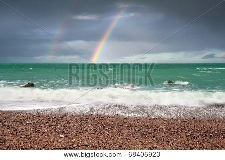 Beautiful Rainbow Over Ocean Coast