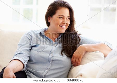 Portrait Of Overweight Woman Sitting On Sofa
