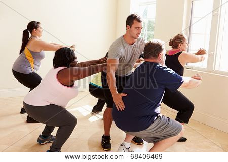 Fitness Instructor In Exercise Class For Overweight People
