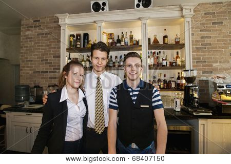 Portrait of confident waitstaff in restaurant