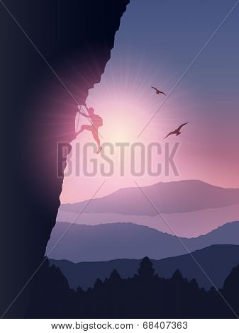 Silhouette of a rock climber climbing a mountain against a sunset sky