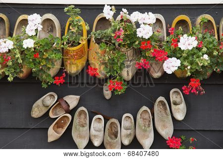 Clogs - Shoes On A Wooden Wall.